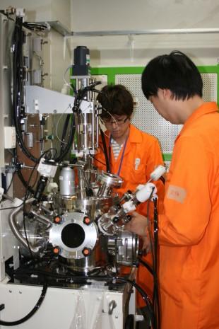 Training in synthesizing actinide compounds using a tetra-arc furnace (Tohoku University).