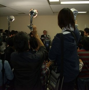 Mr Yagi, surrounded by the press