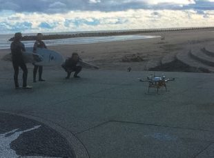 Test of drone testing delivering warm drinks to surfers. (c) METI