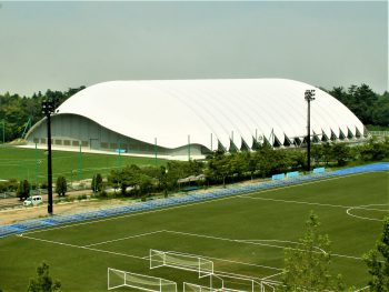 J-Village will soon be fully reopened. The white-roofed structure is an all-weather, year-round football training site.(July. 2018)
