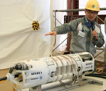 Hitachi-GE chief engineer Yoshio Nonaka explains the submersible ROV-A (being used to install a guide ring)